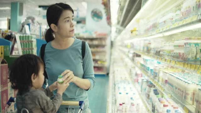 asian mother and son shopping in a supermarket - cart stock videos & royalty-free footage
