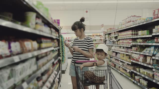 Asian mother and son shopping in a supermarket