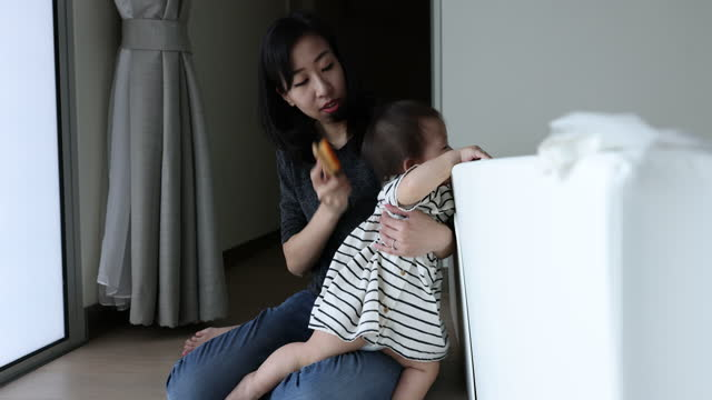 asian mother brushing hair for her baby daughter - hair accessory stock videos & royalty-free footage