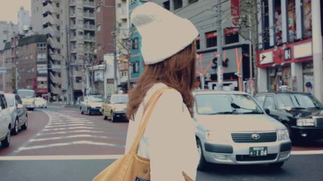 asian mother holding walking on the street. - crossing stock videos & royalty-free footage
