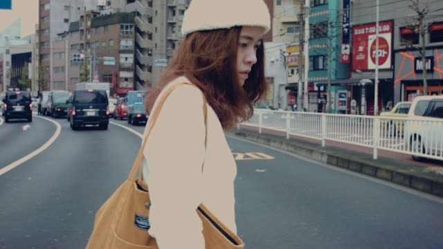 asian mother holding walking on the street. - only japanese stock videos & royalty-free footage