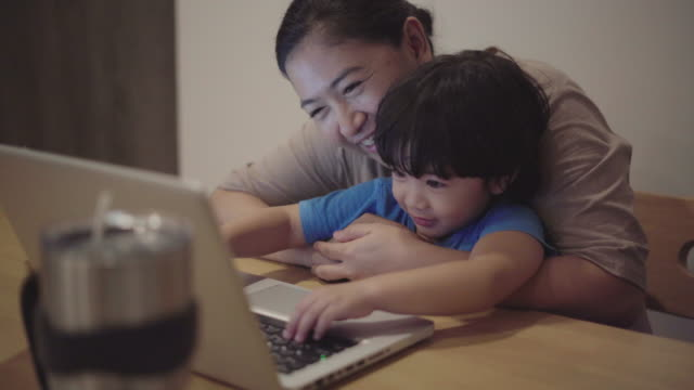 asian mother is working at home - real people stock videos & royalty-free footage