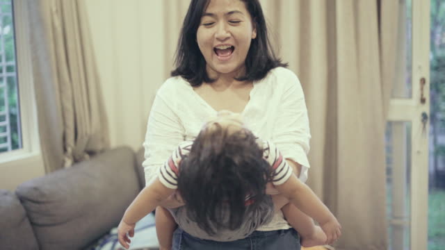 asian mother playing with baby boy (12-23 months) - 12 23 months stock videos & royalty-free footage