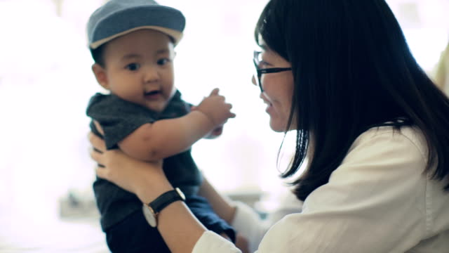 asian mother talking with baby boy (6-11 months) - 6 11 months stock videos & royalty-free footage
