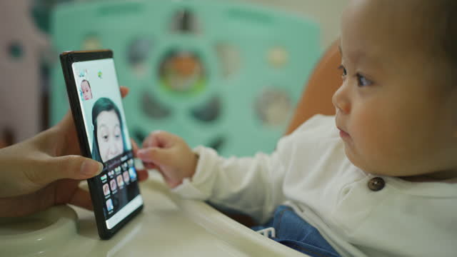 asian mother talks to son on smart phone . - the ageing process stock videos & royalty-free footage