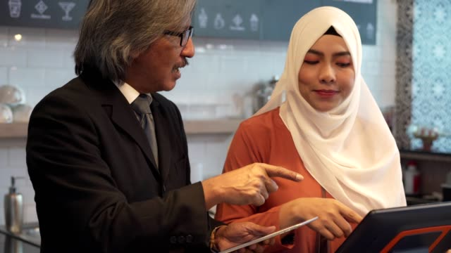 asian muslim people discuss or learing about coffee business in cafe. - hijab stock videos & royalty-free footage