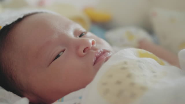 asian newborn sleeping on the bed. thailand. - crib stock videos & royalty-free footage