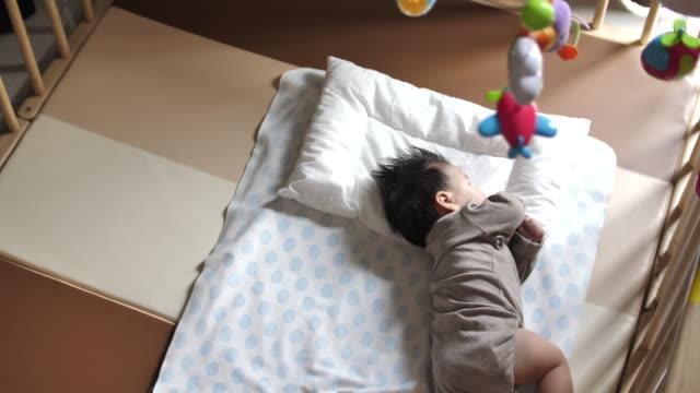 asian newborn sleeping - duvet stock videos & royalty-free footage