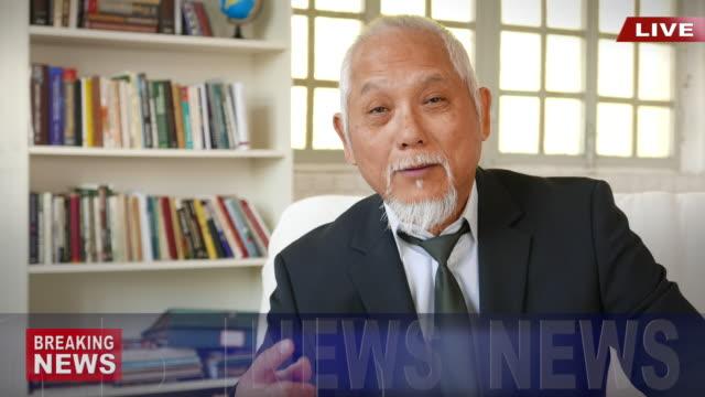 4 k の場所にアジア ニュース キャスター - 政治家点の映像素材/bロール
