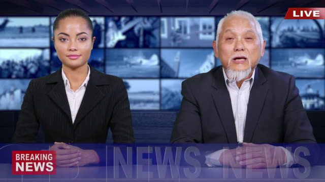 4k asian newscaster reading the breaking news - news event stock videos & royalty-free footage