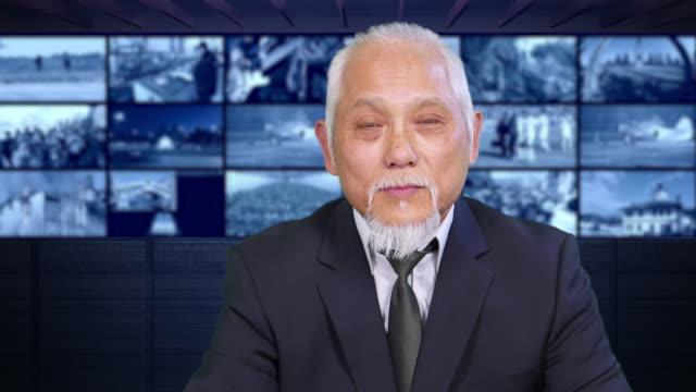 vídeos de stock, filmes e b-roll de 4k asiáticos newscaster lendo as notícias - ocupação na mídia