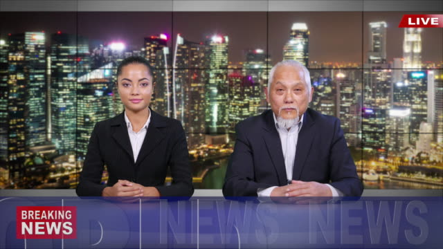 4k asian newscasters reading the breaking news - breaking news stock videos & royalty-free footage