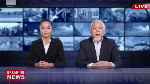 4k asian newscasters reading the breaking news - film montage stock videos & royalty-free footage