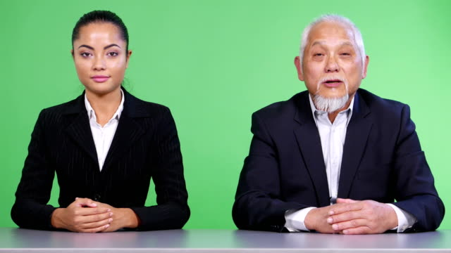 4k asian newscasters reading the breaking news - presenter stock videos & royalty-free footage