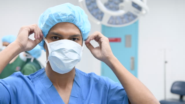 asian nurse removing surgical mask and smiling - removing stock videos & royalty-free footage