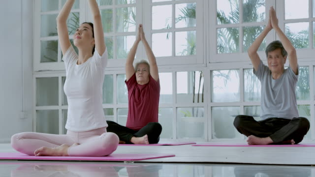 asian of multi-generation family doing yoga to home exercise. family, lifestyle, people, multi-generation, elderly, vacations, relationship, children, retirement, healthy care, leadership, seniors in sport concept. - zen like stock videos & royalty-free footage