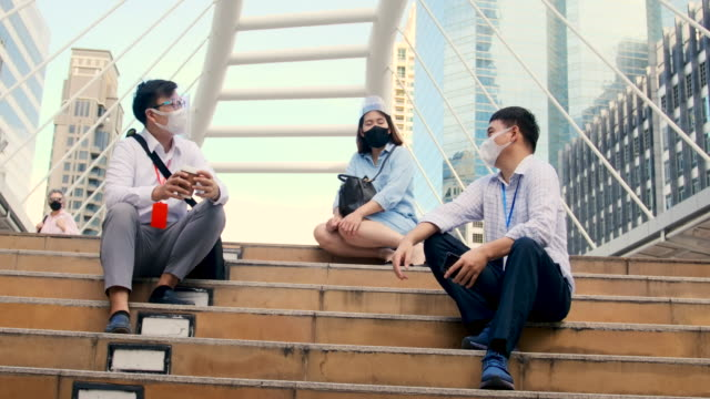 asian office workers wear masks on their faces. come to meet. - distante video stock e b–roll