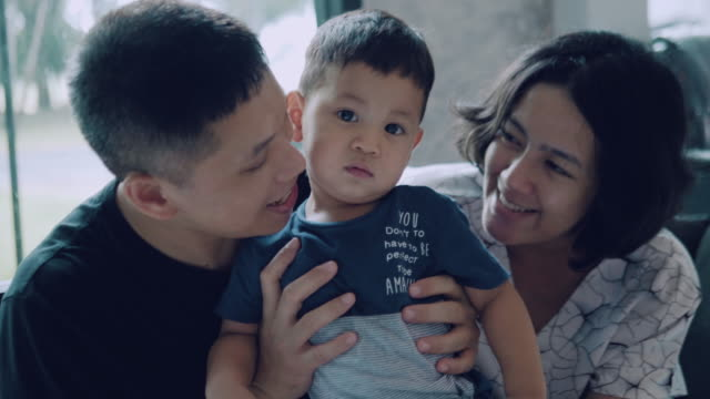 asian parent and son at home. - young family stock videos & royalty-free footage