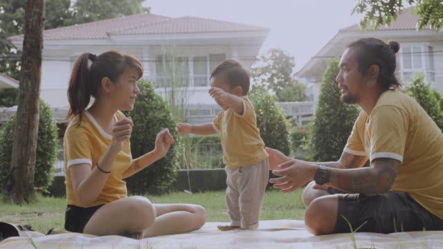 asian parent helping to walk baby (6-11months) boy - steps stock videos & royalty-free footage