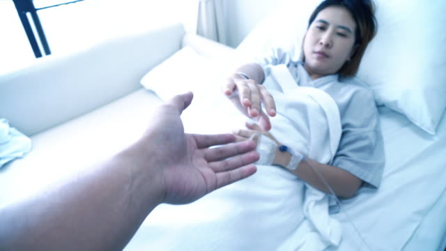 Asian Patient ill in bed Holding hand Families