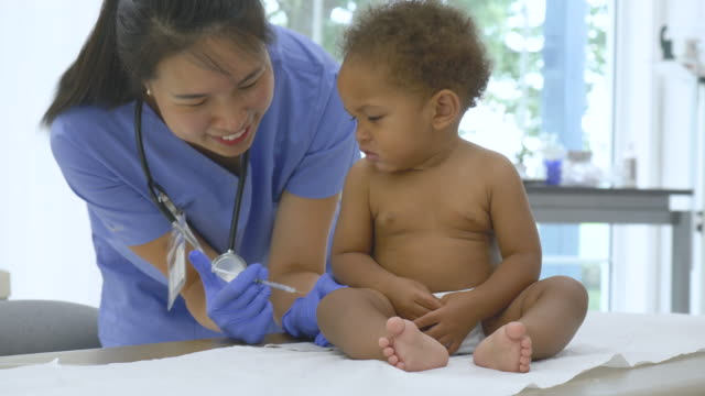 asian pediatrician giving a baby a vaccination - injecting stock videos & royalty-free footage