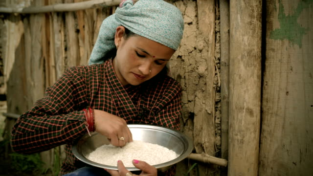 asian people: a rural woman winnowing rice grain - wood grain stock videos and b-roll footage