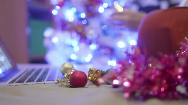 asian people are hanging christmas decorations in their bedrooms. - christmas tree lighting ceremony stock videos & royalty-free footage