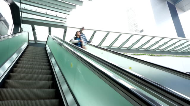 asian people on pedestrian escalator, time lapse. - physical activity stock videos & royalty-free footage