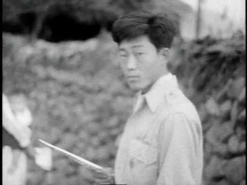 asian people reading pamphlets / korea - 1953 stock videos & royalty-free footage