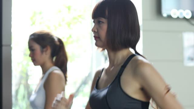 asian personal trainer coaching Run On Treadmill
