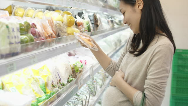 asian pregnant woman shopping in supermarket - quality control stock videos & royalty-free footage