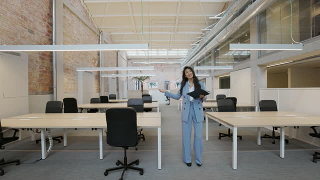 asian realtor showing modern coworking space - full length stock videos & royalty-free footage