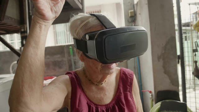 asian senior female have fun and wearing virtual reality glasses. - grandmother stock videos & royalty-free footage