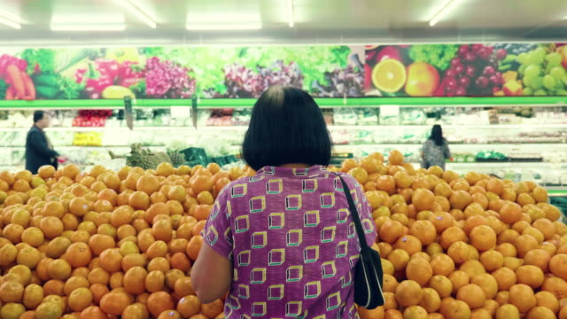 asian senior grocery shopping - orange fruit stock videos and b-roll footage
