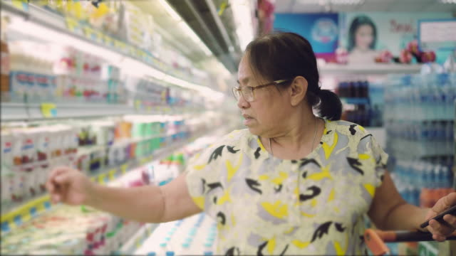 asian senior grocery shopping - label stock videos & royalty-free footage