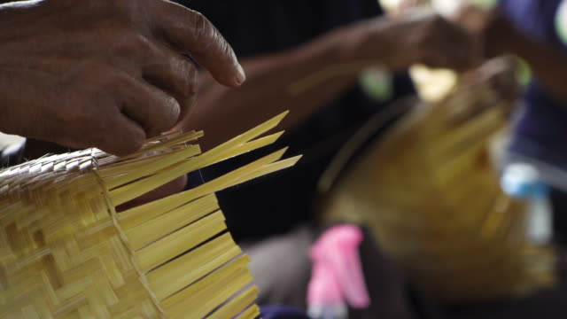 asian senior hand craft making, hands weaving bamboo basket, concept : handmade, traditional. - hammer stock videos & royalty-free footage