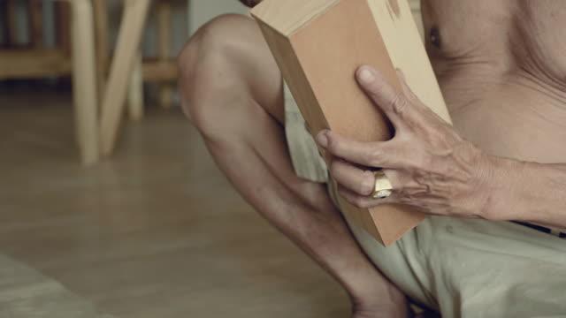 asian senior man renovating old furniture - only senior men stock videos and b-roll footage