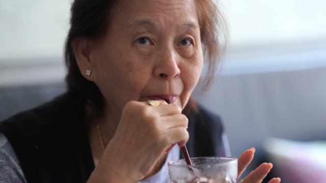asian senior woman drinking ice smoothie  from straw , retirement concept - over 80 stock videos and b-roll footage