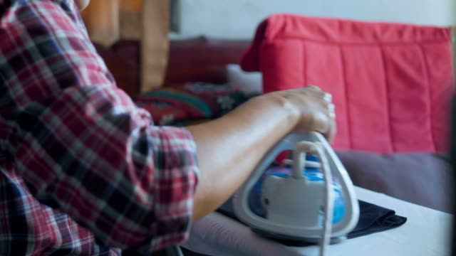 asian senior woman ironing - iron appliance stock videos & royalty-free footage