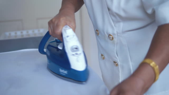 asian senior woman ironing - ironing board stock videos & royalty-free footage