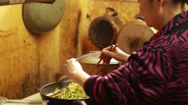 asian senior woman is cooking - north vietnam stock videos & royalty-free footage
