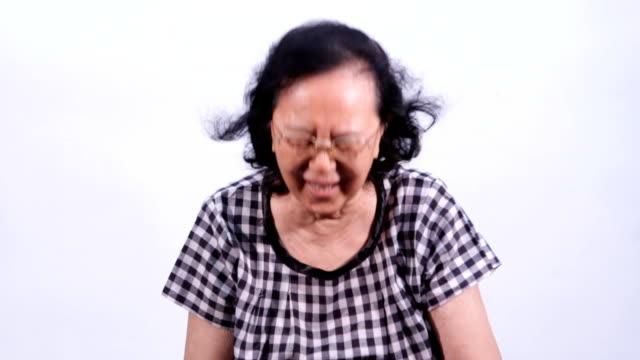 Asian senior woman laughing