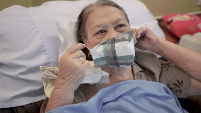 asian senior woman patient wearing medical face mask in hospital - human kidney stock videos & royalty-free footage