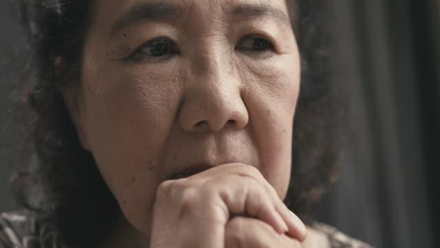 asian senior woman portrait of worry and thinking at her home - dementia stock videos & royalty-free footage