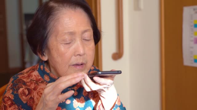 asian senior woman using speech recognition - 80 89 years stock videos & royalty-free footage