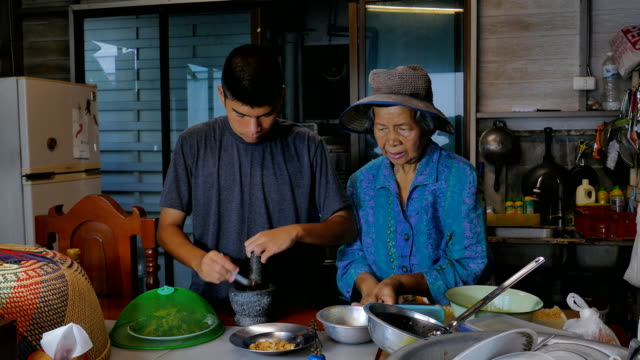 asian senior women and grandson was cooking in kitchen. - traditionally vietnamese stock videos & royalty-free footage