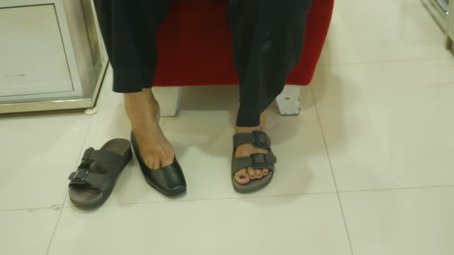 asian senior women fitting new shoe at store - piede umano video stock e b–roll