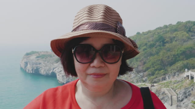 asian senior women with sun hat and eyeglass - sun hat stock videos & royalty-free footage