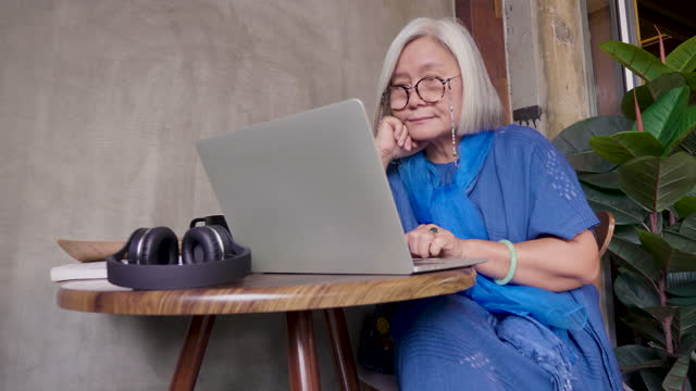 asian senior women working with laptop computer while sitting in coffee shop cafe, people lifestyle technology concept - working seniors stock videos & royalty-free footage