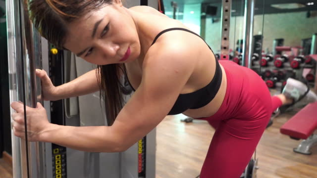 asian sexy woman workout in gym - deltoid stock videos & royalty-free footage